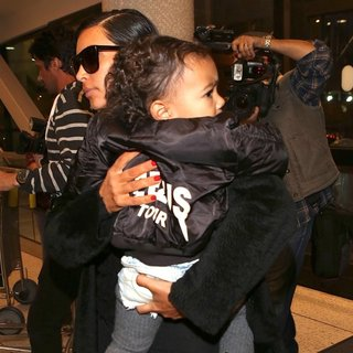 Kim Kardashian - Kim Kardashian and North West Arrive at Los Angeles International