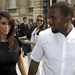 Kim Kardashian, Kanye West in Paris Fashion Week Fall-Winter 2013 - Valentino - Departures