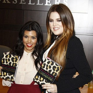 Kourtney Kardashian, Khloe Kardashian in Khloe Kardashian and Kourtney Kardashian Sign Copies of Their New Book Dollhouse