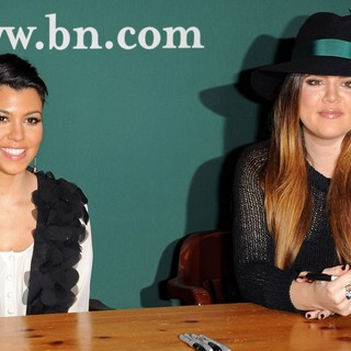 Kourtney Kardashian, Khloe Kardashian in Kourtney Kardashian and Khloe Kardashian Sign Copies of of Kardashian Konfidential