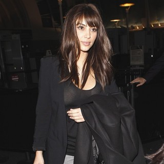 Kim Kardashian in Kim Kardashian Arrives at LAX Airport with A New Haircut featuring Bangs