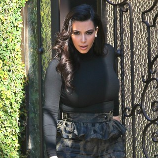 Kim Kardashian in Kim Kardashian Departs Her Home in Peplum Pants