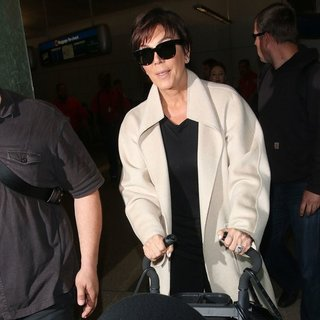 Kris Jenner in The Kardashian Family Arrive at Los Angeles International Airport - kris-jenner-arrive-at-los-angeles-international-airport-02
