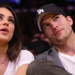 Mila Kunis, Ashton Kutcher in Celebrities Watch The LA Lakers vs. Phoenix Suns