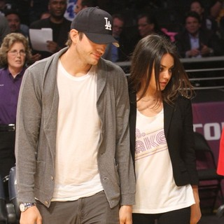 Ashton Kutcher, Mila Kunis in Celebrities Watch The LA Lakers vs. Phoenix Suns