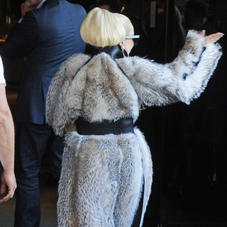 Lady GaGa in Lady GaGa Carries A Puppy as She Leaves Her Hotel