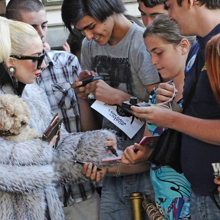 Lady GaGa - Lady GaGa Carries A Puppy as She Leaves Her Hotel