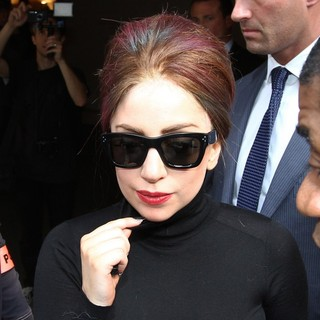 Lady GaGa in Lady GaGa Signs Autographs for Fans as She Leaves Her Hotel