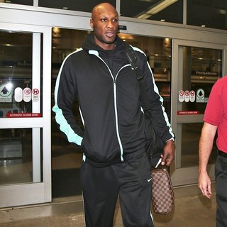 Lamar Odom Arrives at Los Angeles International Airport