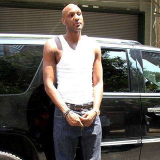 Lamar Odom in Lamar Odom Waiting Outside A Vehicle While Posing for Photographs