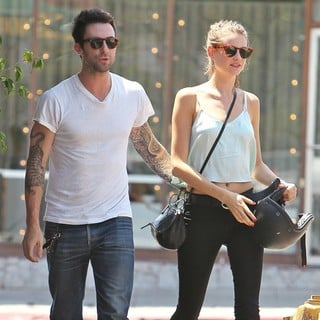 Adam Levine, Behati Prinsloo in Adam Levine and Behati Prinsloo Return to His Parked Motorcycle