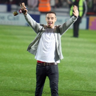 Liam Payne, One Direction in Liam Payne Supports Louis Tomlinson as He Takes Part in A Charity Football Match