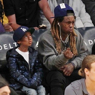 Lil Wayne at The Los Angeles Lakers Game with His Son
