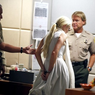 Lindsay Lohan in Lindsay Lohan Being Escorted from The Courtroom in Handcuffs After A Judge Revoked