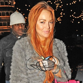 Lindsay Lohan in Lindsay Lohan Heads Back to The Dorchester Hotel After Shopping at Harrods