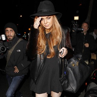 Lindsay Lohan in Lindsay Lohan Leaving Dan Tana's Restaurant After Having Dinner with Her Lawyer Mark Heller