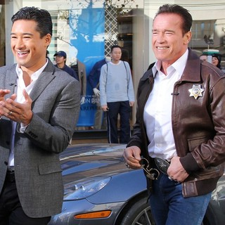 Mario Lopez, Arnold Schwarzenegger in Arnold Schwarzenegger Drives A Sheriff Truck to The Grove to Promote Film The Last Stand on Extra