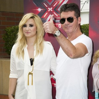 Demi Lovato, Simon Cowell in Fox's The X Factor Judges