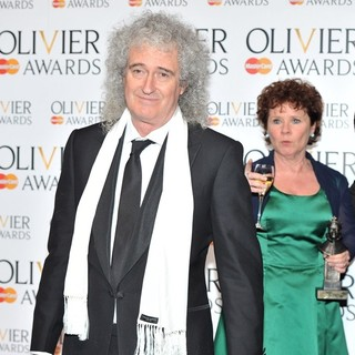 Brian May, Imelda Staunton in The Olivier Awards 2013 - Press Room