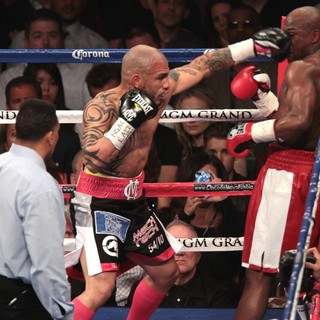 Miguel Cotto, Floyd Mayweather, Jr. in The Fight Floyd Mayweather, Jr. Defeated Miguel Cotto by Way of A Twelve Round Unanimous Decision