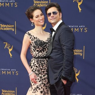 Caitlin McHugh, John Stamos in 2018 Creative Arts Emmy Awards - Day 1 - Arrivals