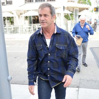 Mel Gibson in Mel Gibson Wearing A Plaid Shirt while Out Shopping in Beverly Hills