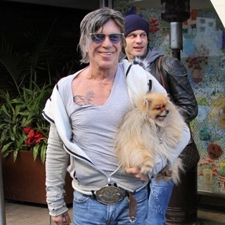 Mickey Rourke Carries His Pet Dog as He Leaves Cafe Roma on Christmas Eve