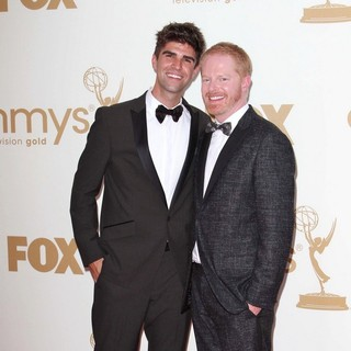 Justin Mikita, Jesse Tyler Ferguson in The 63rd Primetime Emmy Awards - Arrivals