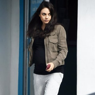 Mila Kunis Shows Off Her Baby Bump