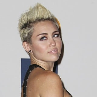 Miley Cyrus in Clive Davis and The Recording Academy's 2013 Pre-Grammy Gala and Salute to Industry Icons