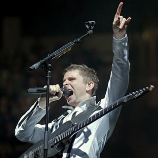Matthew Bellamy, Muse in Muse Performing Live in Concert
