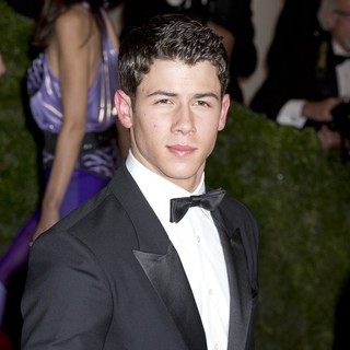 Nick Jonas, Jonas Brothers in Schiaparelli and Prada Impossible Conversations Costume Institute Gala