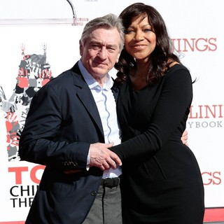 Robert De Niro, Grace Hightower in Robert De Niro Places His Hand and Foot Prints in Cement During The Footprint Ceremony