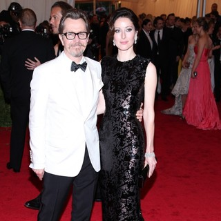 Gary Oldman, Alexandra Edenborough in Schiaparelli and Prada Impossible Conversations Costume Institute Gala