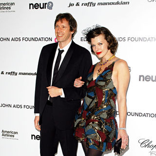 Milla Jovovich, Paul W.S. Anderson in 18th Annual Elton John AIDS Foundation Academy Awards (Oscars) Viewing Party - Arrivals