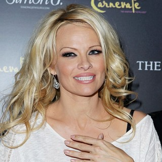 Pamela Anderson in Simon G. Jewelry's Summer Soiree and The Kickoff of Carnevale Nights