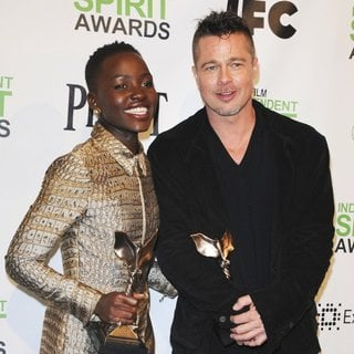 Lupita Nyong'o, Brad Pitt in The 2014 Film Independent Spirit Awards - Press Room