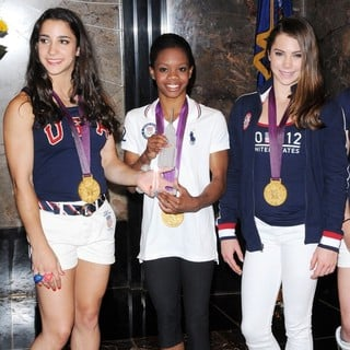 Aly Raisman, Gabrielle Douglas, McKayla Maroney in US Women's Gymnastics Team Attending A Lighting Ceremony