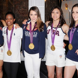 Aly Raisman, Gabrielle Douglas, McKayla Maroney, Kyla Ross, Jordyn Wieber in US Women's Gymnastics Team Attending A Lighting Ceremony