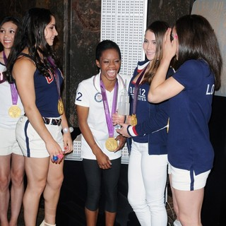 Kyla Ross, Aly Raisman, Gabrielle Douglas, McKayla Maroney, Jordyn Wieber in US Women's Gymnastics Team Attending A Lighting Ceremony