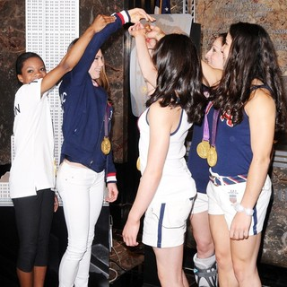 Gabrielle Douglas, McKayla Maroney, Kyla Ross, Jordyn Wieber, Aly Raisman in US Women's Gymnastics Team Attending A Lighting Ceremony