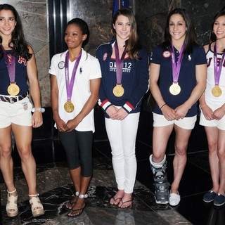 Aly Raisman, Gabrielle Douglas, McKayla Maroney, Jordyn Wieber, Kyla Ross in US Women's Gymnastics Team Attending A Lighting Ceremony