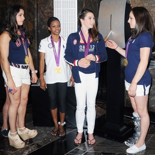 Aly Raisman, Gabrielle Douglas, McKayla Maroney, Jordyn Wieber in US Women's Gymnastics Team Attending A Lighting Ceremony