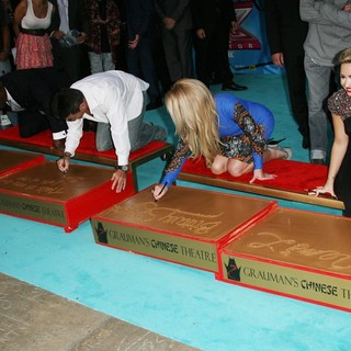 L.A. Reid, Simon Cowell, Britney Spears, Demi Lovato in The X Factor Season Two Premiere Screening and Handprint Ceremony