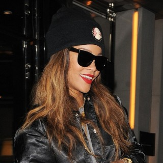 Rihanna in Rihanna Appears in Good Spirits as She Leaves Her Hotel