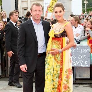 Guy Ritchie, Jacqui Ainsley in Harry Potter and the Deathly Hallows Part II World Film Premiere - Arrivals