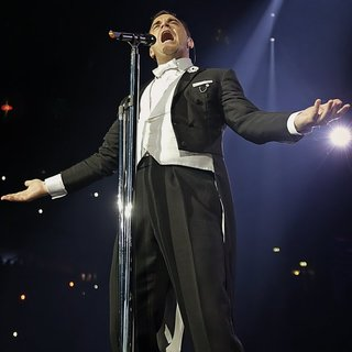 Robbie Williams Performing Live on Stage