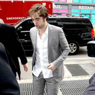Robert Pattinson - Robert Pattinson is surrounded by photographers while leaving ABC studios