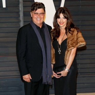 Robbie Robertson, Lydia Andrich in 2015 Vanity Fair Oscar Party