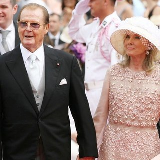 Roger Moore, Kristina Tholstrup in Religious Ceremony of The Royal Wedding of Prince Albert II of Monaco to Charlene Wittstock